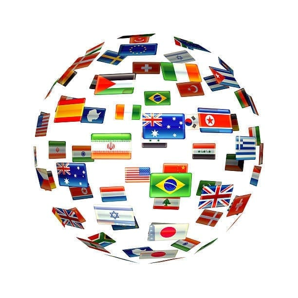 Globe of world flags on a simple white background.